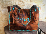Cowhide bag with stones