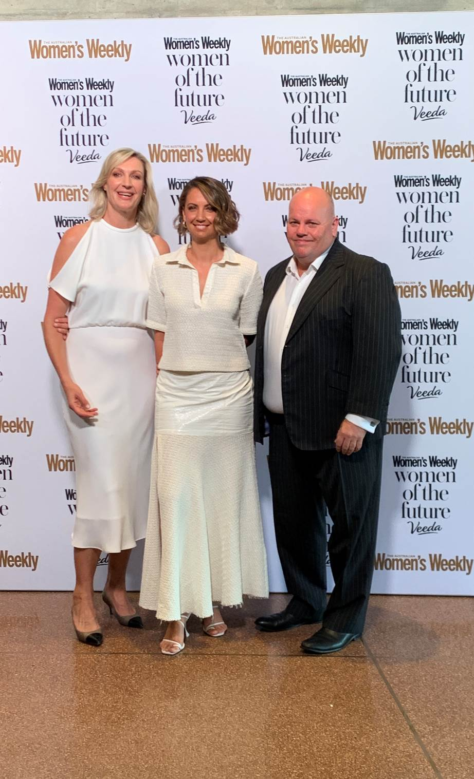 Women's Weekly Editor-In-Chief Nicole Byers, the event MC and TV icon Brooke Boney and Veeda CEO Adrian Forsyth share a red carpet snap.