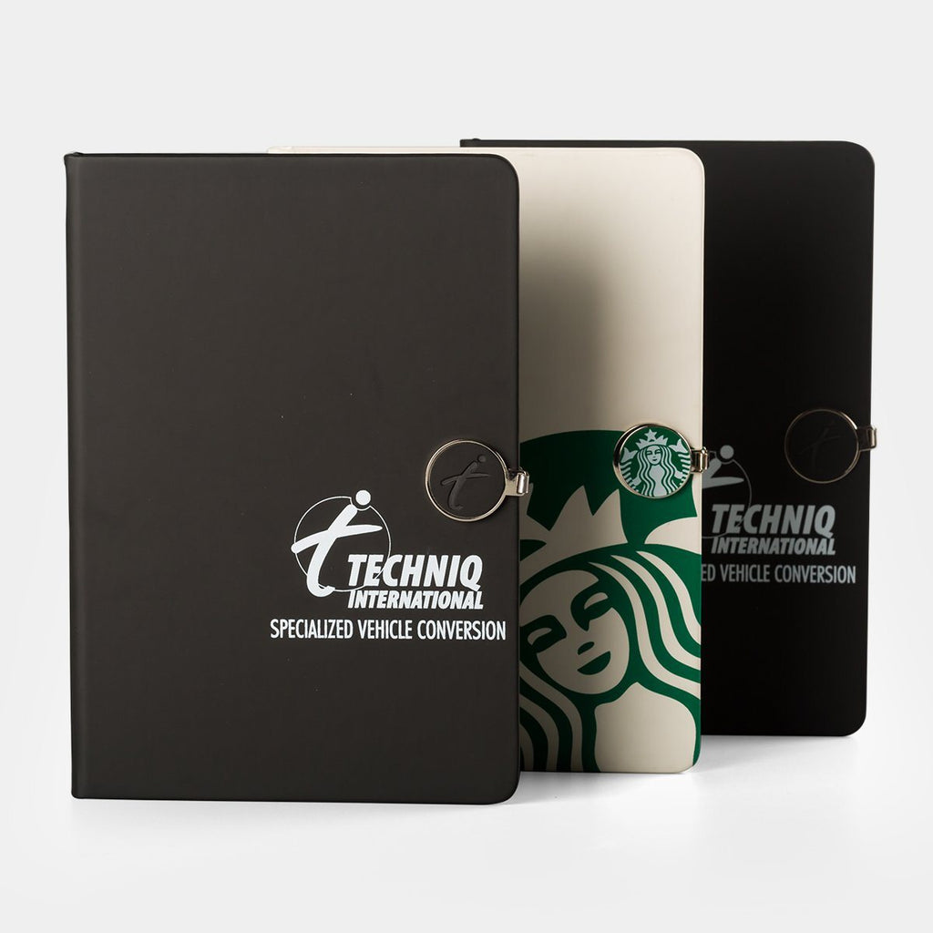 Notebook with replaceable badge