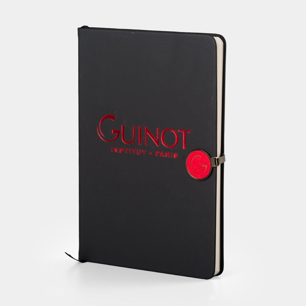 Notebook with round PU badge