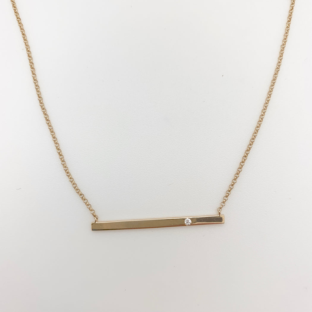 Gold Bar with single Pave Diamond