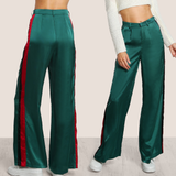 Wide leg green pants with red and black stripes on the side