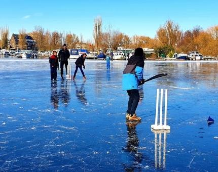 Playing cricket on icy canals in Amsterdam