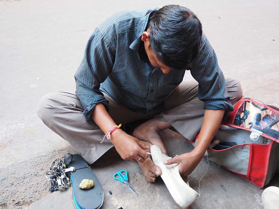 Pushkar India Mending Shoes