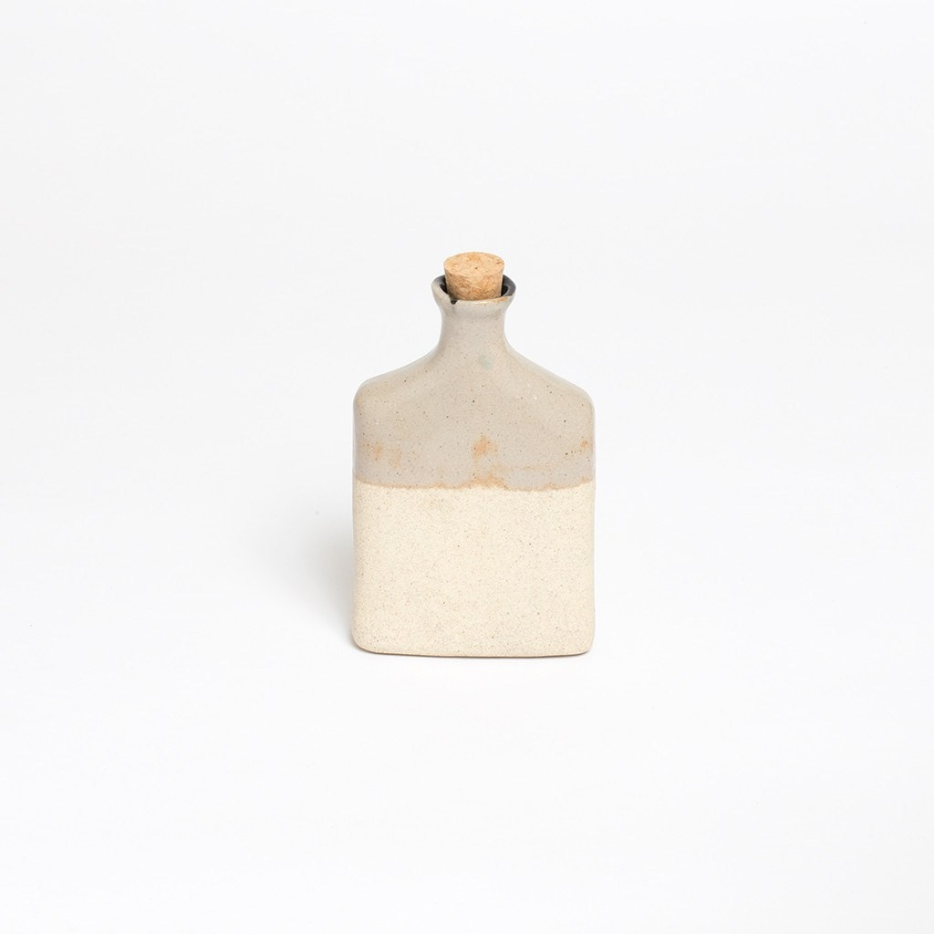 Claymen ceramic flask with dripping glaze