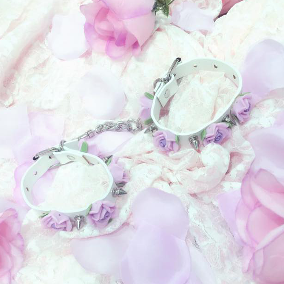 Faux leather handcuffs with kawaii lolita flowers and studs/spikes ♥ #kawaiikink style cuffs with buckle closure ♥ available in pink, white or purple ♥ International shipping