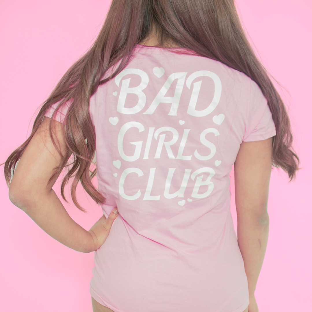 Pink and white BAD GIRLS CLUB t-shirt top with hearts and text on both the front and back of the top.