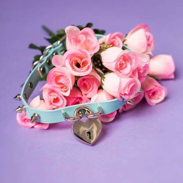 Baby Voodoo Aqua Blue Spiked Pastel Goth Collar Choker with Heart Lock and spikes pink roses and purple background