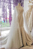 Rent: BRAMANTA WIJAYA V-Neck Wedding Dress with Detachable Cape