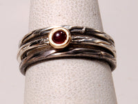 Ruby cabochon in gold on silver stack ring