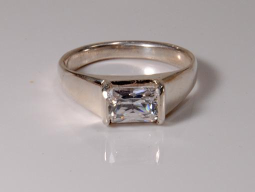 engagement ring with radiant cut diamond