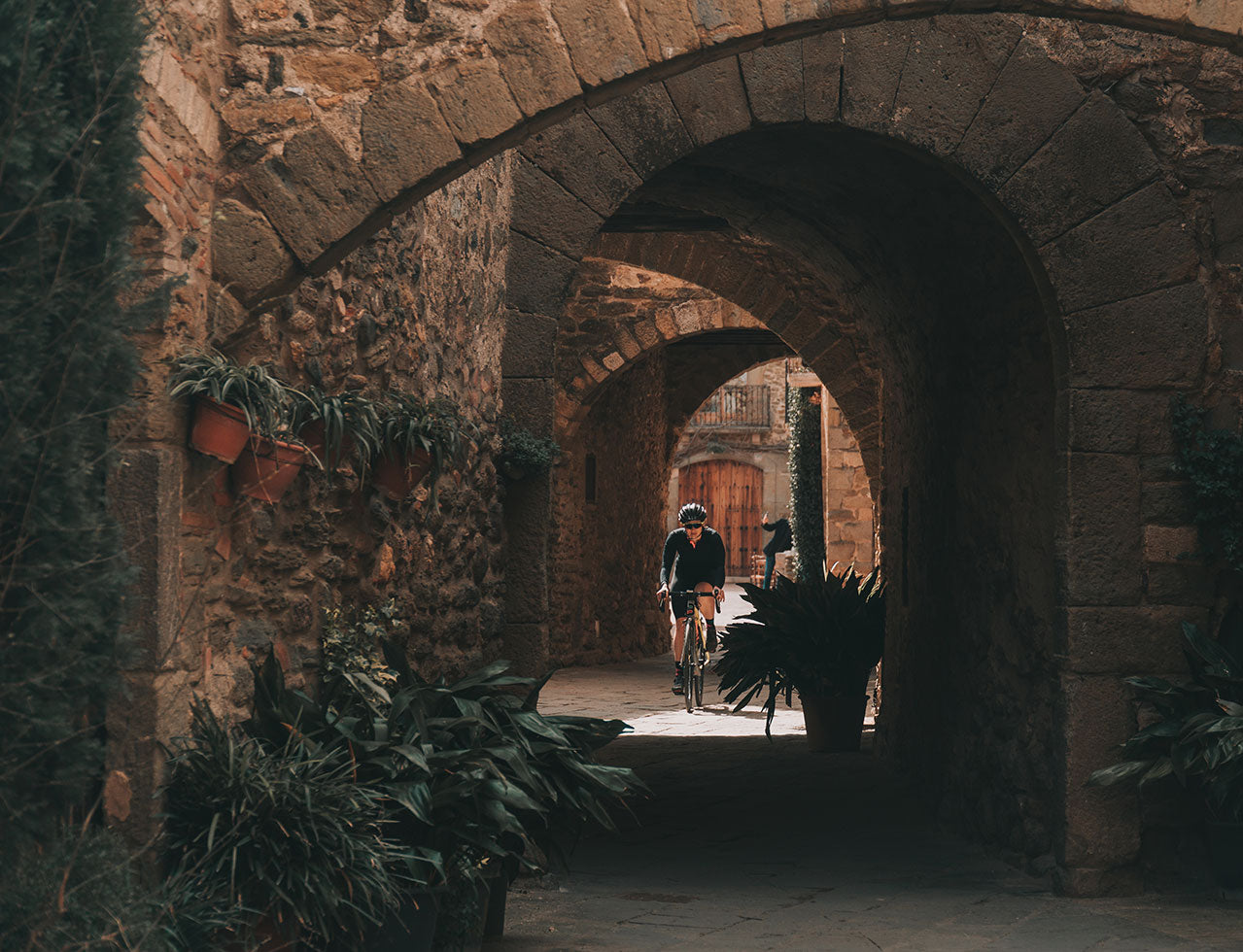 Cycling through the arches in Girona
