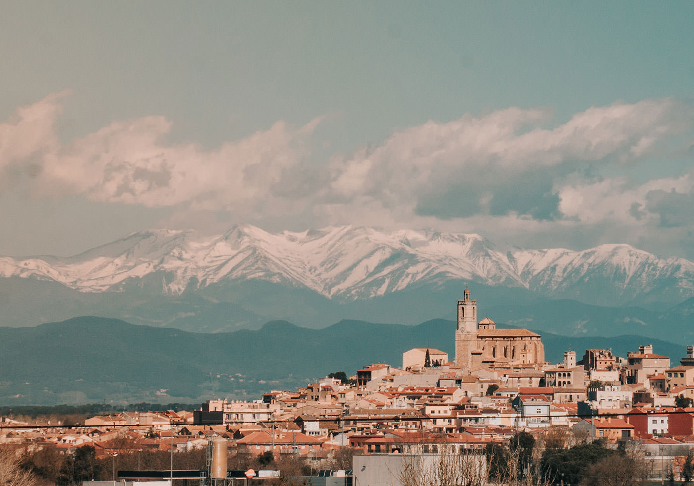 Girona with the Pyrenees mountains in the background