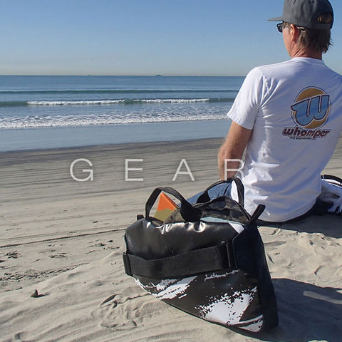 Bodysurfing Gear on The Beach and Bodysurfer Looking at The Waves