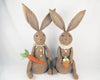 "Birch Maison Decorative Primitive / Farmhouse Sitting Fabric Bunny Couple with Collar & Scarf, Checkered Ears, holding a Carrot & a Basket with Eggs, Brown, Assorted, Set of 2 - 28"" Tall"