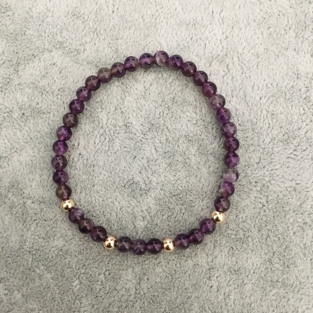 Pink, purple and gold stack