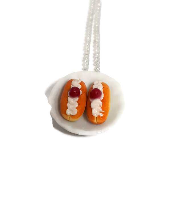 Swiss cream buns cakes on a plate necklace