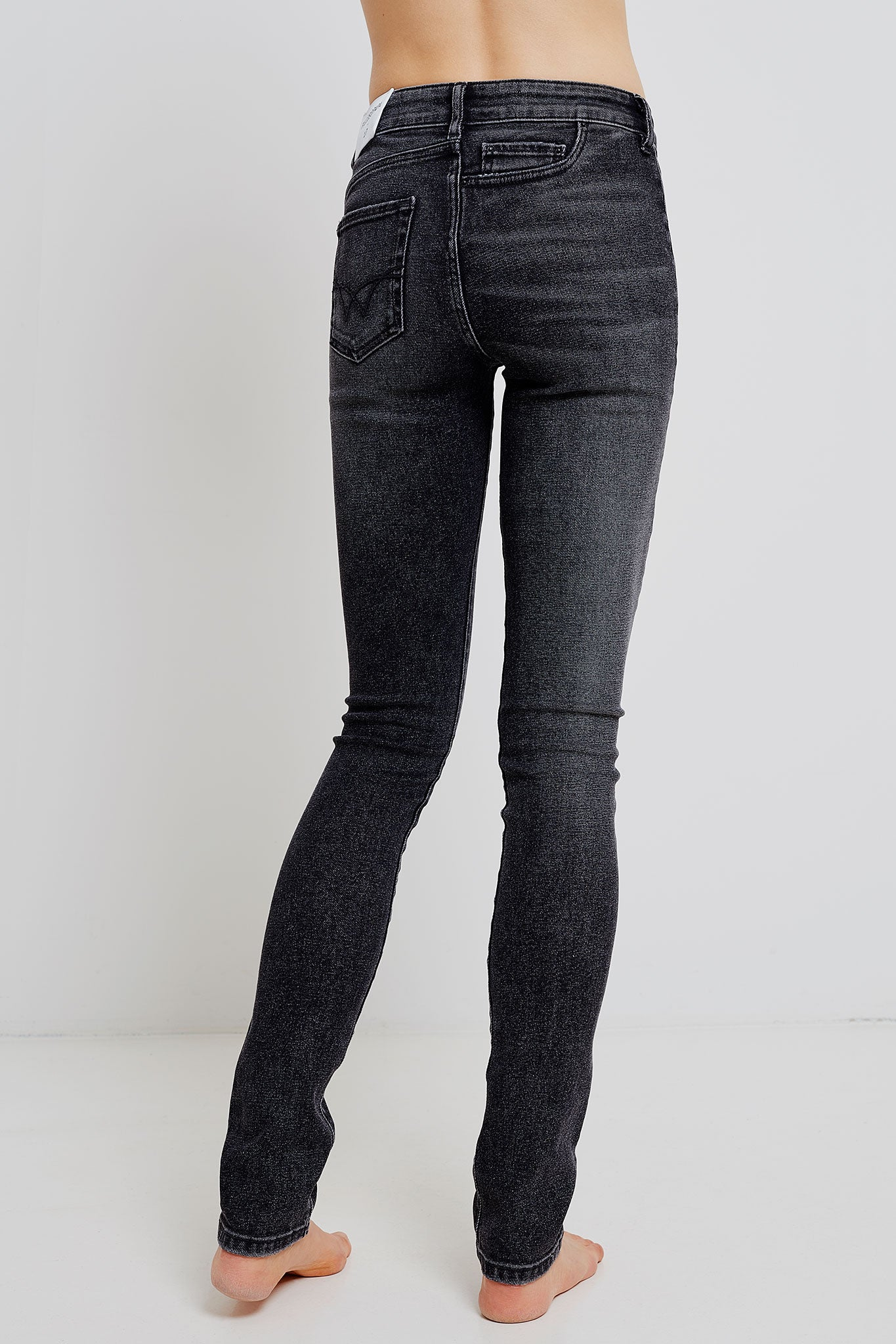 woman twisted slim jeans
