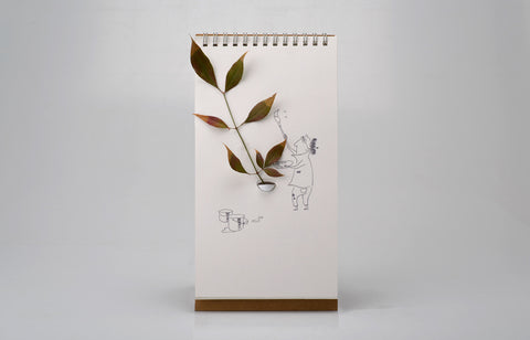 Flip Vase Display with Integrated Vase & Cartoon Illustrations