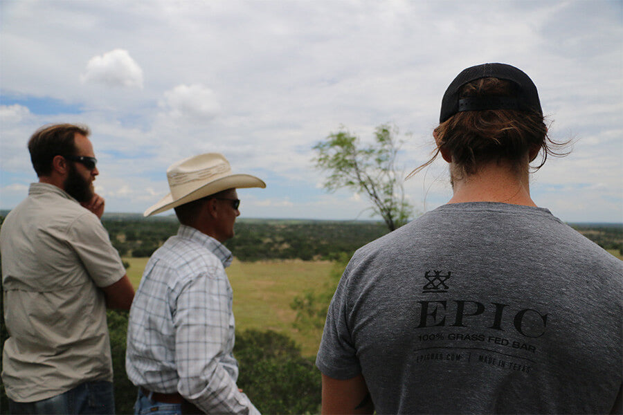 EPIC's head of sourcing, Kirk Blanchard, Chad Lemke, and EPIC co-founder Taylor Collins take in the view from a bluff on Lemke's property.
