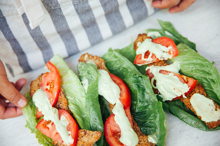 Three jalapeno crackling coated blt wraps laying on a table.