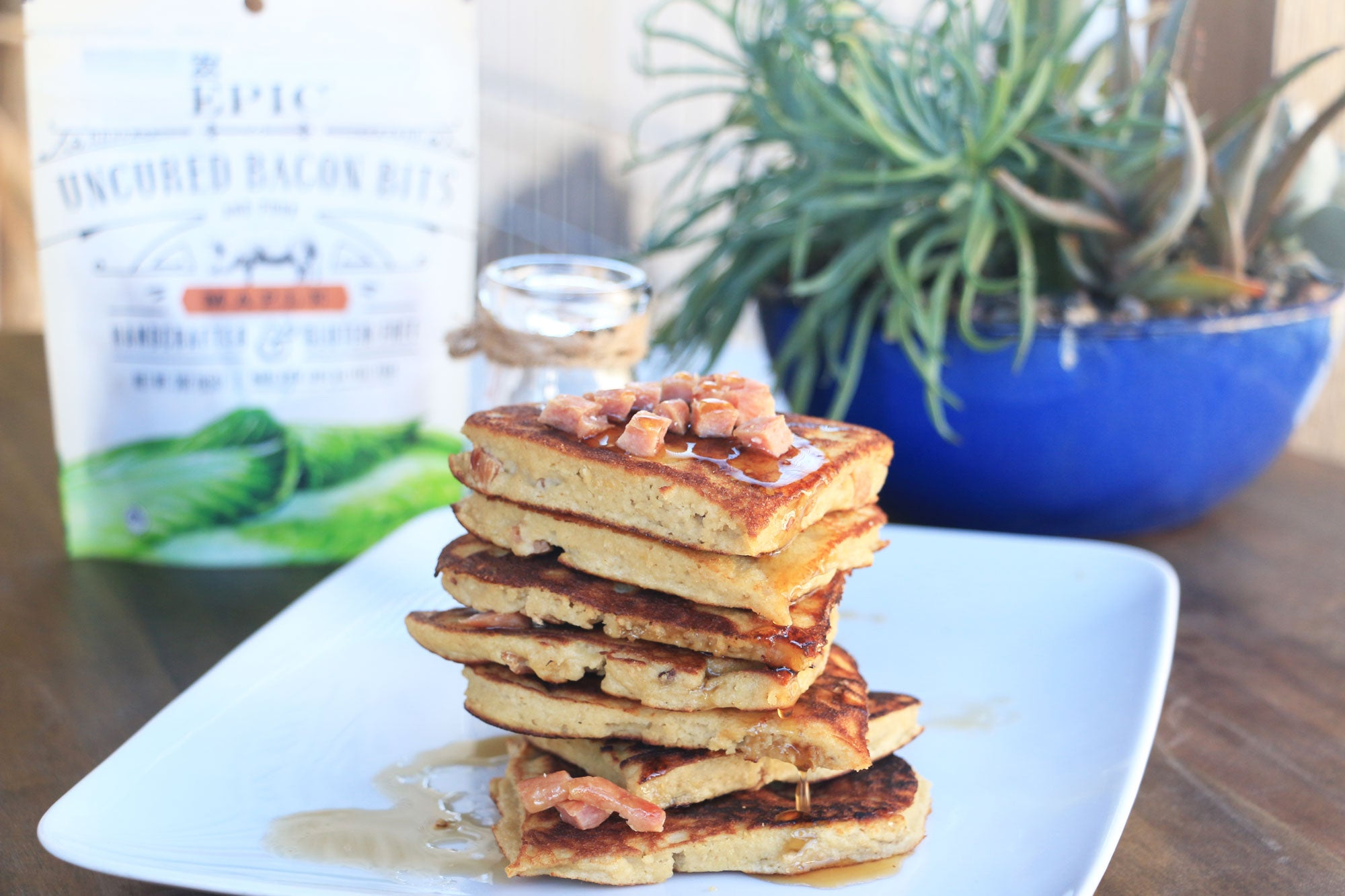 Stack of pancakes topped with EPIC bacon bits