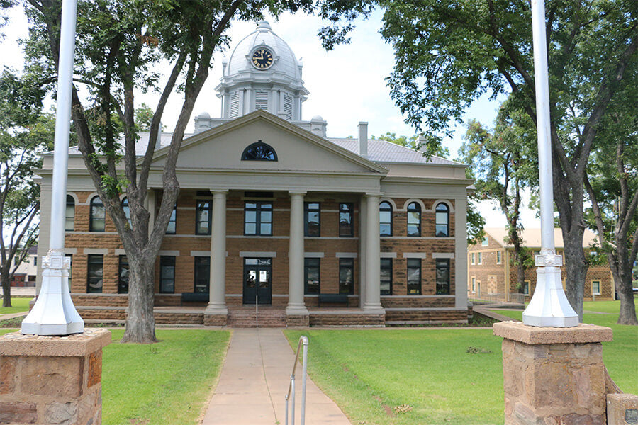 Built in 1909, the Mason County Courthouse stands at the center of the tree-lined town square.