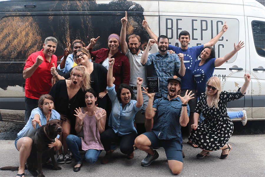 EPIC team in funny poses in front of van