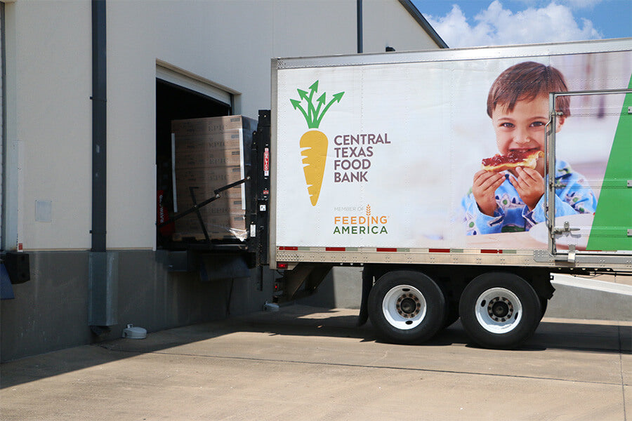 Boxes of EPIC product being loaded into a Central Texas Food Bank Truck