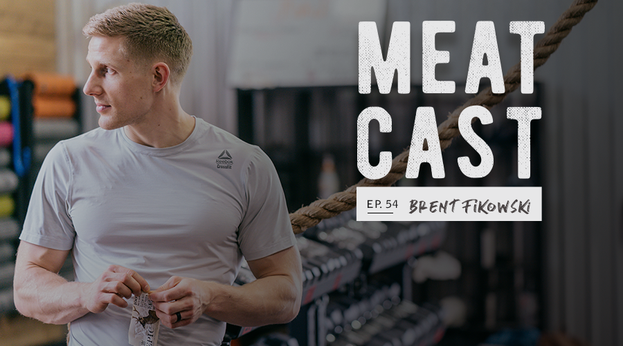 "Strong man eating EPIC Bar in gym with text ""meatcast ep. 54 – Brent Fikowski"""
