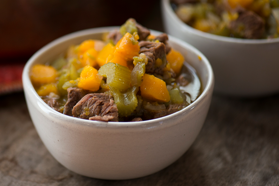 Bowl of beef stew with butternut squash and celery