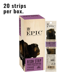 Single box of bison snack strips next to a single bison snack strip on a white background
