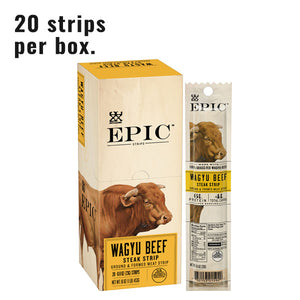 single box of wagyu beef snack strips next to a single wagyu beef snack strip on a white background