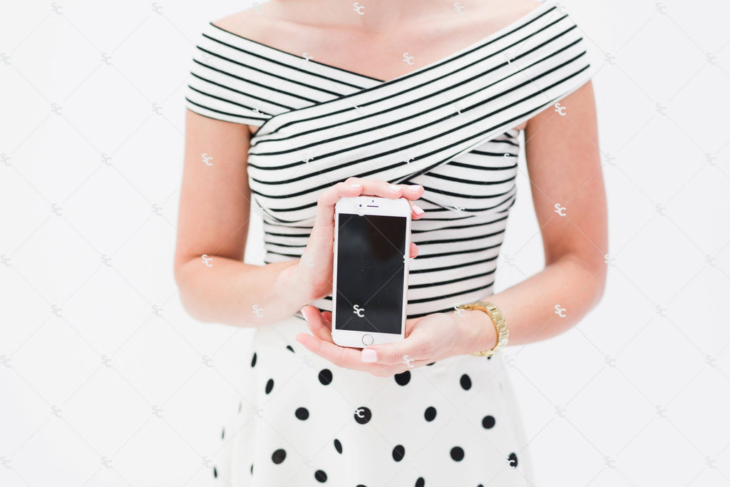 Black and white styled stock photography. Woman holding phone stock image