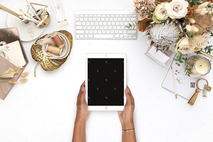 warm neutral styled stock photo with ipad and dark skin hands