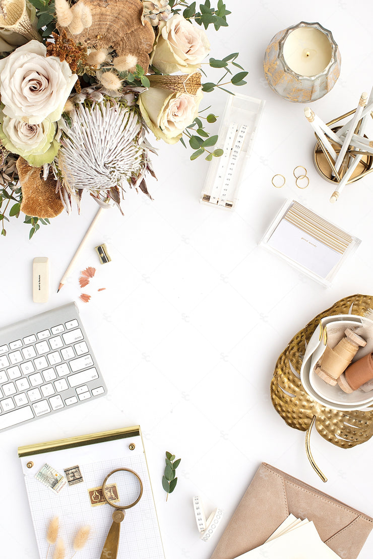 warm neutral desktop styled photo with florals, gold accents, a keyboard, and notepad