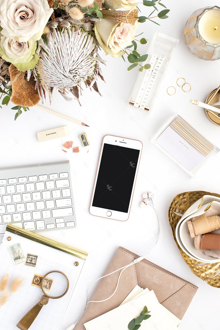 warm neutral desktop photo with neutral flowers, iphone, keyboard, and gold accents