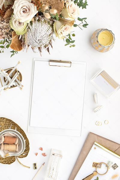 warm neutral desktop image with neutral flowers, gold accents, and blank paper