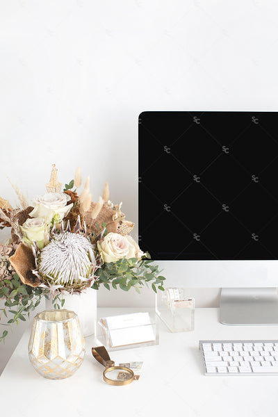 warm neutral desktop computer image with neutral floral display