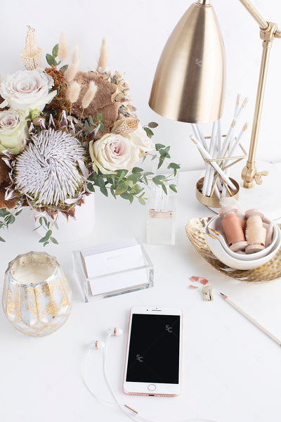 warm neutral desktop with neutral florals, iphone, gold accents, and a gold desk lamp