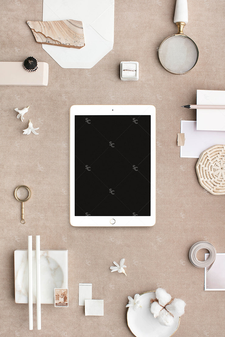 Bone and neutral stationery styled stock with a tablet