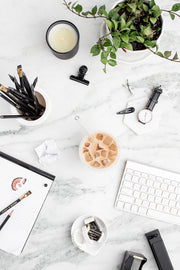 Black and white styled stock desk collection on a marble background