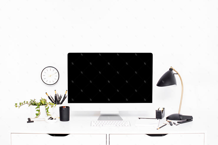Black and white styled stock desk collection on a marble background with computer