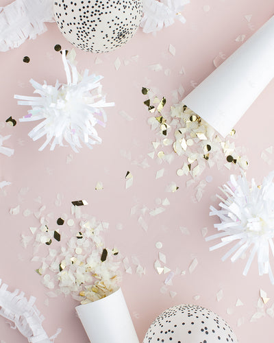 This beautifully styled blush and white party flat lay is designed to celebrate New Year's