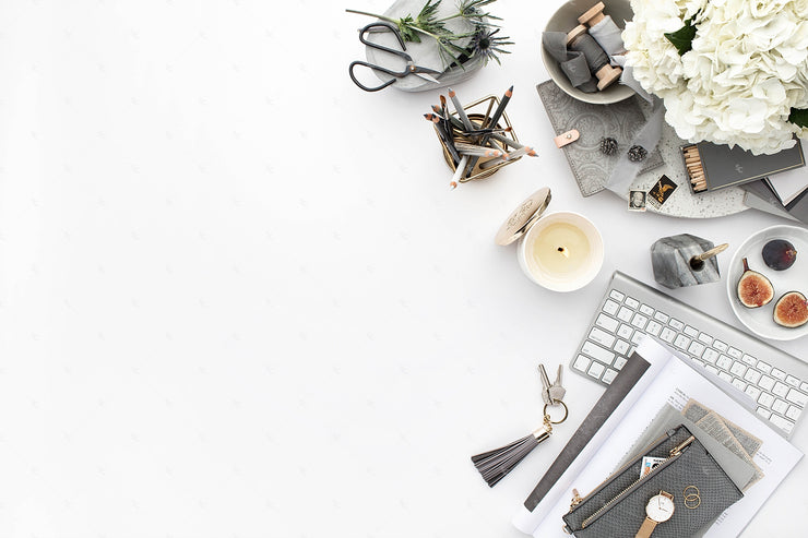 Grey desktop styled stock flatlay with grey and white accents, blank space, and a keyboard