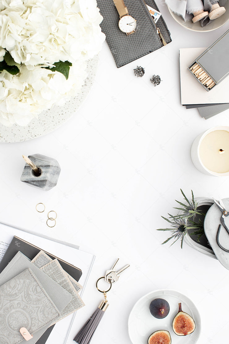 Grey desktop styled stock flatlay with white flowers, grey accents