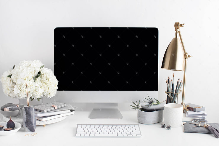 Grey desktop styled stock image with white flowers, grey accents and desktop computer
