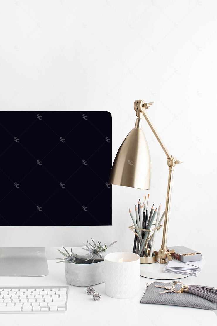 Grey desktop styled stock image with white flowers, grey accents with desktop computer