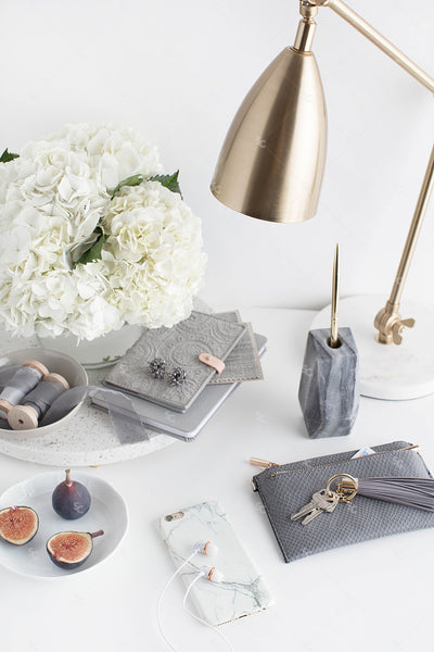 Grey desktop styled stock image with white flowers, grey accents and gold desk lamp