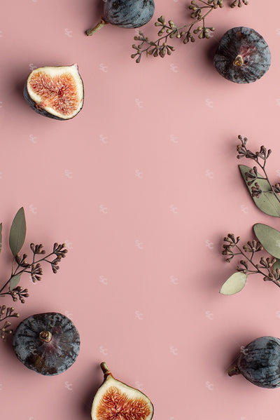 Fall figs and foliage on a pink background